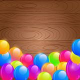 Bright Birthday Balloons on Wooden Background Royalty Free Stock Image