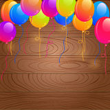 Bright Birthday Balloons on Wooden Background Stock Photography