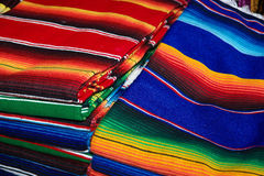 Bright Blankets. Stacks of colorful handwoven blankets Stock Photos