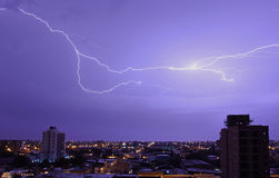 The bright blizzards in the night sky above the city. Line Stock Image