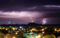 The bright blizzards in the night sky above the city. Line Stock Photography