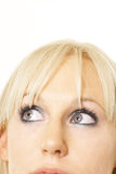 Bright blonde looking up Royalty Free Stock Photography