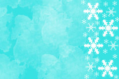 Bright blue background with white snowflakes Stock Photos