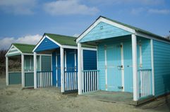 Bright blue beach huts Royalty Free Stock Photo
