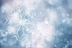 Bright blue blurry snowflakes background Stock Photos