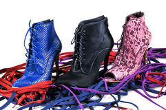 Bright blue, burgundy lace and black fur ankle boots. Footwear of three different colors and materials. Royalty Free Stock Image