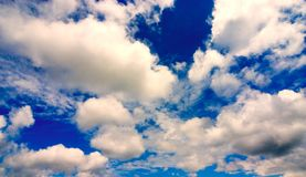 Bright Blue Clouds. White clouds against a bright blue sky royalty free stock photography