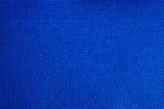 Bright blue color textile fabric surface close up macro texture background.  stock images