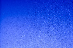 Bright blue color water drops abstract background. Texture royalty free stock photos