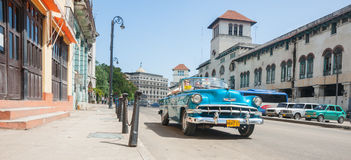 Bright blue convertible 1960`s Chevrolet taxi in Havana street. Royalty Free Stock Images
