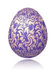 Bright blue Easter egg with gold decorative floral branch Royalty Free Stock Photo
