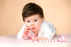 Bright blue eyed 6 month old baby girl Stock Photo