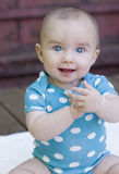 Bright Blue Eyed Happy Baby Girl Stock Photography