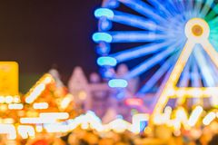 Bright blue Ferris wheel at the Christmas fair. Defocused xmas abstract. Blurred background. Copy space stock photography