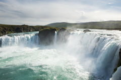 Bright blue Godafoss waterfall on a sunny day, Iceland Royalty Free Stock Image