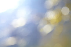 Bright blue and gold colour background Stock Photography