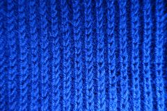 Bright blue handmade rib knit fabric from above. Bright blue hand made rib knit fabric from above Stock Images