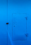 Bright Blue Locked Door and Padlock Stock Image