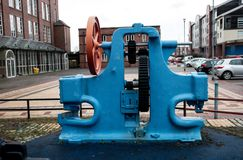 Bright Blue Machine. A bright blue and vibrant machine oute the refurbished mill Stock Images