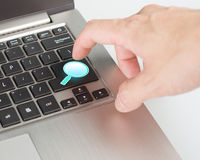 Bright blue magnifier draw search button on the keyboard. Close-up Royalty Free Stock Photo