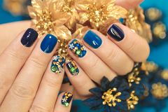 Bright blue manicure with the design of rhinestones stock photos