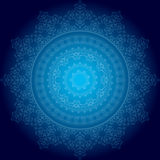 Bright blue ornament on dark blue background Royalty Free Stock Photography