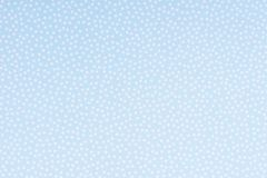 Bright blue paper with white spots and dots texture background.  royalty free stock photo