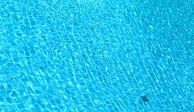 Bright blue pool water Royalty Free Stock Photography