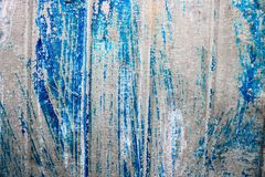 Bright blue saturated relief texture of a beautifully painted metal surface with vertical stripes and shabby peeling paint. The background stock photos