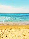 Bright blue sea and sand beach Stock Photos