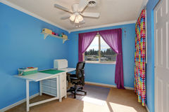 Bright blue sewing room interior with colorful curtains. stock photos