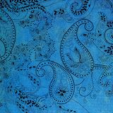 Paisley patterned background in shades blue and black. A bright blue shabby background covered in fancy black elaborate paisley shapes Royalty Free Stock Images