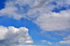 Bright blue skies with many clouds. Background blue sky with white clouds. Beautiful cloudscape with blue sky and white clouds. Bright blue skies with many Stock Photography