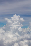 Bright blue sky above the clouds Stock Photography