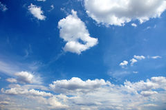 Bright blue sky as background. Beautiful blue summer sky with clouds as background or backdrop Stock Photos