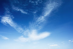 Bright blue sky with clouds Stock Image