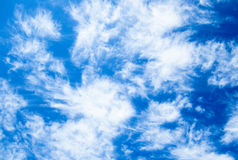 Bright blue sky with clouds Stock Images