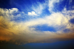Bright blue Sky and Clouds Stock Image
