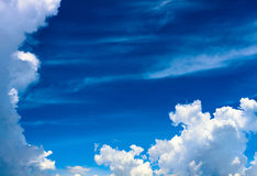 Bright blue sky with clouds. A horizontal shot of bright blue sky with puffy white clouds Royalty Free Stock Photography
