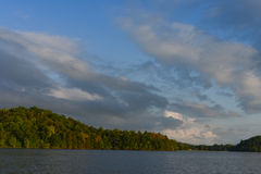 Bright blue sky with clouds over lake. In Minnesota Royalty Free Stock Photography