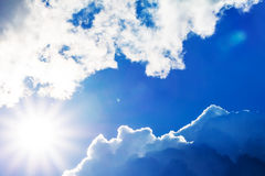 Bright blue sky clouds and sun rays Royalty Free Stock Image