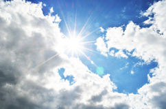 Bright blue sky with clouds and sun rays.  Royalty Free Stock Photos