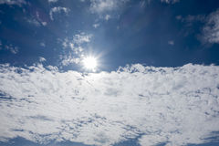 On the bright blue sky. Cloudy sky Stock Images
