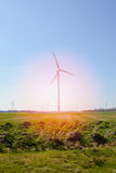 Bright blue sky moving and wind turbine Stock Photos