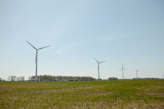 Bright blue sky moving and wind turbine Stock Images