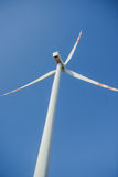 Bright blue sky moving and wind turbine Stock Photography