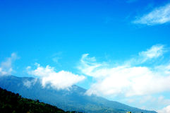 A bright blue sky over the peak. Blue sky with big white clouds over a peak in Cibodas, Puncak, West Java, Indonesia stock photography