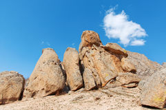 Bright blue sky over the rocks Royalty Free Stock Photos