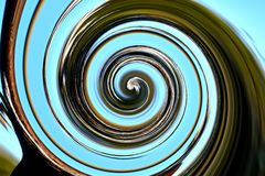 The bright blue sky is twisted into a spiral Royalty Free Stock Photo