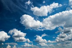 White Fluffy Clouds in the Blue Sky Royalty Free Stock Image